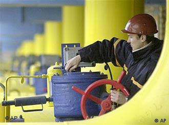 A Ukrainian worker operates valves in a gas storage and transit point in Boyarka