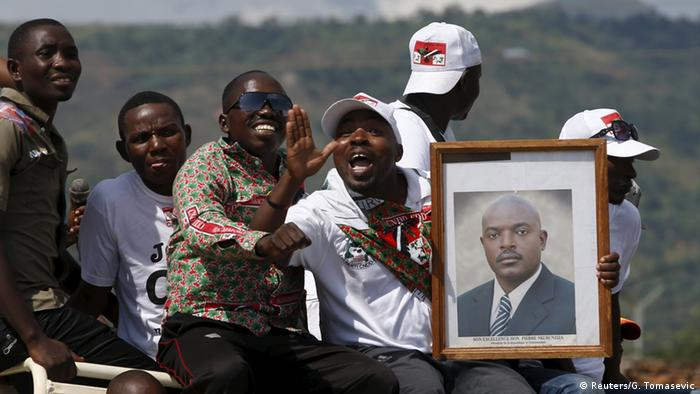 President Nkurunziza's supporters carry his image