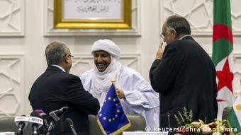 Algerian Foreign Minister Lamamra congratulates CMA secretary-general Bilal Agh Cherif. Photo: REUTERS/Zohra Bensemra
