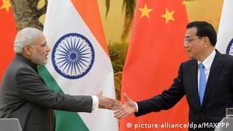 Chinese Premier Li Keqiang (R) and his Indian counterpart Narendra Modi shake hands at the end of their joint press conference at Beijing's Great Hall of the People on May 15, 2015 (Pool photo by Kyodo News)(Kyodo)
