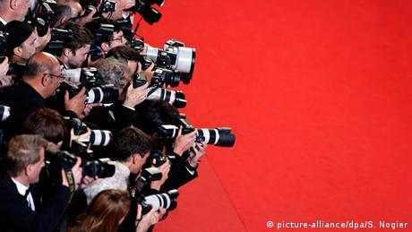 Photographers line the red carpet during the 68th annual Cannes Film Festival, in Cannes, France, 15 May 2015 (Copyright: picture-alliance/dpa/S. Nogier)