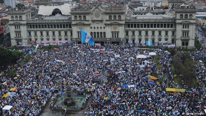 Aerial view taken during a protest to demand the resignation of Guatemalan President Otto Perez as a corruption scandal rocks the government, at Constitution Square in front of the Culture Palace in Guatemala City on May 16, 2015.