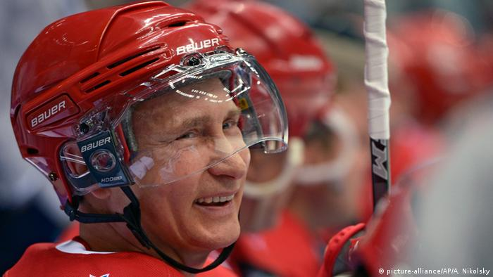 Russian President Vladimir Putin smiles during an exhibition hockey game