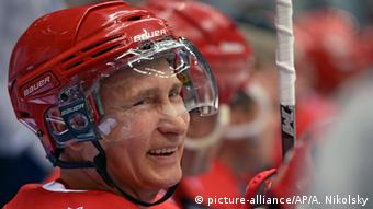 putin in ice hockey garb photo: Alexei Nikolsky/RIA-Novosti, Kremlin Pool Photo via AP