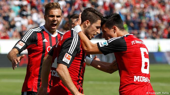 Ingolstadt players celebrate vs. RB Leipzig