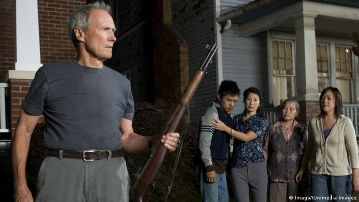 Clint Eastwood holding a gun in Gran Torino (Imago//Unimedia Images)