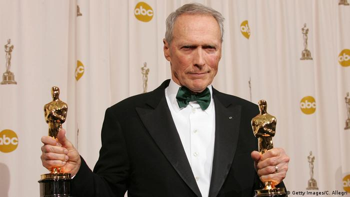 Clint Eastwood poses with his Oscar award for Best Director in Million Dollar Baby backstage during the 77th Annual Academy Awards