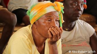A tired looking elderly Sierra Leonean woman