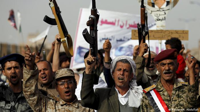 Houthi followers raise their weapons as they demonstrate against Saudi-led air strikes in Yemen's capital Sanaa May 18, 2015.