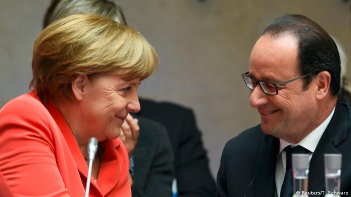 Merkel and Hollande smile at each other during the Petersberg Climate Dialogue (Photo: REUTERS/Tobias Schwarz/Pool)