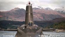 Probe amid Trident safety claims. File photo dated 30/01/02 of the Royal Navy's 16,000 ton Trident-class nuclear submarine Vanguard, as security and safety concerns around the UK's nuclear deterrent are being investigated after a series of claims from a Royal Navy submariner. Able Seaman William McNeilly criticised measures in place around the Trident submarine programme, describing it as a disaster waiting to happen. In an online post he said he is an Engineering Technician Submariner who was on patrol with HMS Victorious this year. He claimed there are fire risks and leaks on board and that security checks are rarely carried out on personnel and contractors working on the submarines when they are docked at Faslane. Issue date: Sunday May 17, 2015. See PA story DEFENCE Trident. Photo credit should read: PA Wire URN:23031835