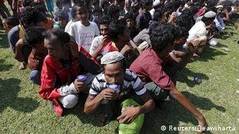 Migrants queuing up for identification in Indonesia REUTERS/Beawiharta