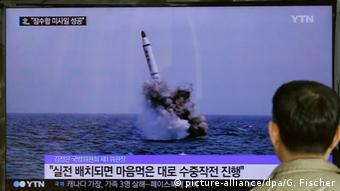 A South Korean man watches a TV news program showing an image published in North Korea's Rodong Sinmun newspaper of North Korea's ballistic missile believed to have been launched from underwater, at Seoul Railway station in Seoul, South Korea, Saturday, May 9, 2015 (AP Photo/Ahn Young-oon)