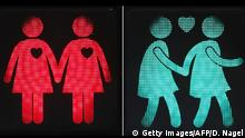 12.05.2015 A combination of pictures taken on May 12, 2015 shows new traffic lights showing female same-sex couples in Vienna. On the occasion of the upcoming Life Ball, the Eurovision Song Contest and the Rainbow Parade in Vienna, the Austrian capital with its new traffic lights wants to promote tolerance and raise awareness to better road safety. AFP PHOTO / DIETER NAGL (Photo credit should read DIETER NAGL/AFP/Getty Images)