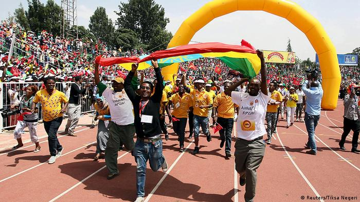 EPRDF supporters run down a sports track cheering. Photo: REUTERS/Tiksa Negeri