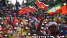 21.05.2015 *** A youth waves the ruling party Ethiopian Peoples Revolutionary Democratic Front (EPRDF) flag in front of a large crowd during an election rally by the EPRDF on May 21, 2015 in Addis Ababa. On May 24, Ethiopian will hold its fifth general election which will take place across the country. The EPRDF has won the last four general elections by a wide margin. AFP PHOTO/ ZACHARIAS ABUBEKER (Photo credit should read ZACHARIAS ABUBEKER/AFP/Getty Images)