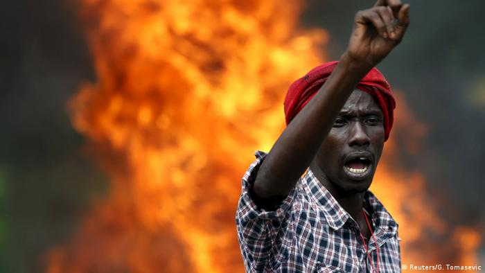 A protester gestures in front of a burning barricade during a protest against Burundi President Pierre Nkurunziza and his bid for a third term in Bujumbura, Burundi, May 21, 2015 (Photo: REUTERS/Goran Tomasevic)