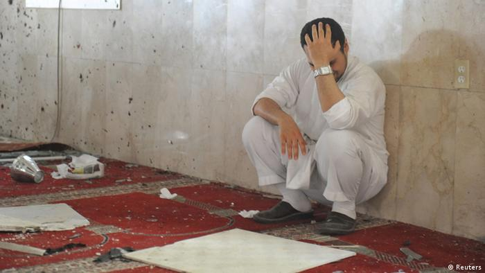 A family member of a slain victim mourns after arriving at the Imam Ali mosque, the site of a suicide bomb attack, in the village of al-Qadeeh in the eastern province of Gatif, Saudi Arabia, May 22, 2015.