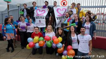 Supporters of gay marriage with balloons and placards