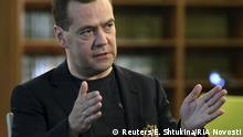 Russian Prime Minister Dmitry Medvedev speaks during an interview in Moscow region, Russia, May 22, 2015. Russia would adopt a tough position if Ukraine decided not to pay off debts owed to Moscow by its previous government, Medvedev said in an interview broadcast by Russian TV on Saturday. Picture taken May 22, 2015. REUTERS/Ekaterina Shtukina/RIA Novosti/Pool ATTENTION EDITORS - THIS IMAGE HAS BEEN SUPPLIED BY A THIRD PARTY. IT IS DISTRIBUTED, EXACTLY AS RECEIVED BY REUTERS, AS A SERVICE TO CLIENTS. TPX IMAGES OF THE DAY