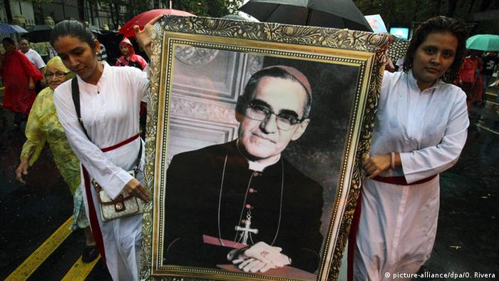 Devotees hold a portrait of late Catholic Archbishop of El Salvador Oscar Romero