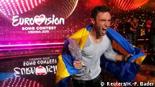 Singer Mans Zelmerloew representing Sweden poses with the trophy after winning the final of the 60th annual Eurovision Song Contest in Vienna, Austria May 23, 2015. REUTERS/Heinz-Peter Bader