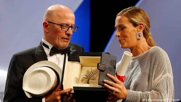 Jane Campion being awarded with the Palme d'Or by French director Jacques Audiard. Campion is the only female filmmaker to ever win the Palme (Getty Images/AFP/V. Hache)