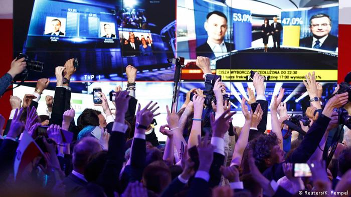 Supporters of PiS candidate Andrzej Duda react with joy to the result of exit polls on May 24, 2015