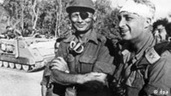 General Moshe Dayan (l) with Ariel Sharon on the Egyptian side of the Suez Canal