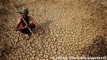 26.05.2015****epaselect epa04768849 An Indian farmer sits in his dried up land in gauribidanur village, doddaballapur district, which is very close to Karnataka and Andhra Pradesh border around 85km from Bangalore, Indian, 26 May 2015. More than 500 people have died in a heat wave that has swept across India and is showing little signs of abating. The southern states of Andhra Pradesh and Telangana were the worst affected with temperatures reaching 48 degrees in some areas. Heat wave conditions have prevailed in the region since April but most of the deaths have been reported over the past 10 days, a news report said. EPA/JAGADEESH NV