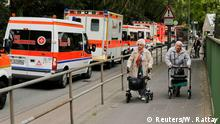 27.05.2015+++ Pensioners use their walking frames to leave their retirement home as ambulance vehicles line up to evacuate handicapped people from Cologne's social firms in Cologne, Germany, May 27, 2015. Some 1,300 inhabitants of the home and a total of more than 20,000 people had to be evacuated on Wednesday for the defusing of a 440-pound bomb dropped during World War Two by the U.S. Air Force. REUTERS/Wolfgang Rattay