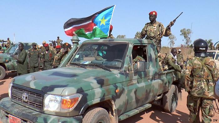 A ute showing government soldiers holding guns in Bentiu