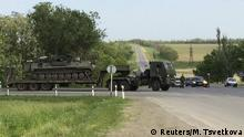 A truck transports an armored military vehicle near the Russian southern town of Matveev Kurgan, near the Russian-Ukrainian border in Rostov region, Russia, May 26, 2015. Picture taken with a mobile phone. REUTERS/Maria Tsvetkova