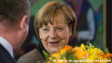 Deutschland Merkel Blumenstrauß Symbolbild