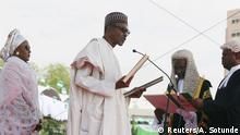 *** 29.05.2015 ***Chief Justice of Nigeria Mahmud Mohammed swears in Muhammadu Buhari as Nigeria's president at the Eagle Square in Abuja, Nigeria May 29, 2015. REUTERS/Afolabi Sotunde