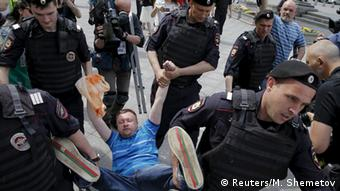 The leading gay rights activist Nikolai Alexeyev was arrested during the rally