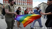 30.5.2015 Anti-gay protesters try to tear a rainbow flag during an LGBT (lesbian, gay, bisexual, and transgender) community rally in central Moscow, Russia, May 30, 2015. REUTERS/Maxim Zmeyev