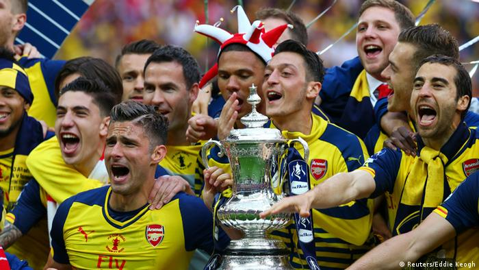 Mesut Özil celebrates winning the 2014/2015 FA Cup with his team at Wembley