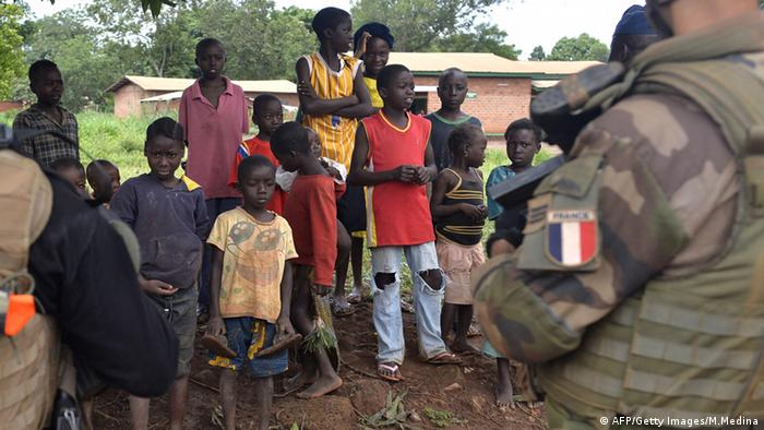 A French soldier and a group of children in Central African Republic MIGUEL MEDINA/AFP/Getty Images)