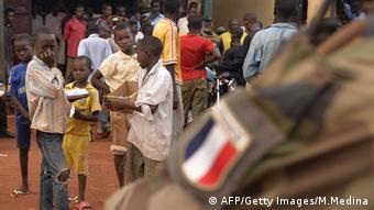 A French soldier patrols a street in Bagui in the Central African Republic