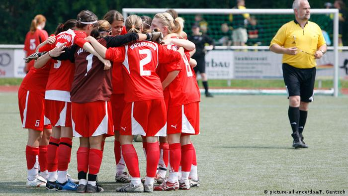 German amateur football side goes into a huddle