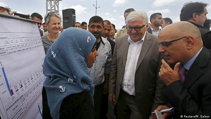 Germany's Foreign Minister Frank-Walter Steinmeier (C) is briefed on a German-funded project for fishermen during his visit to the Seaport of Gaza City June 1, 2015.