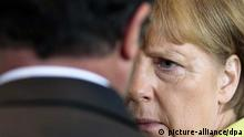 German Chancellor Angela Merkel, right, listens to the President of France Francois Hollande after a statement for the media prior to a meeting at the chancellery in Berlin, Germany, Monday, June 1, 2015. (AP Photo/Markus Schreiber)