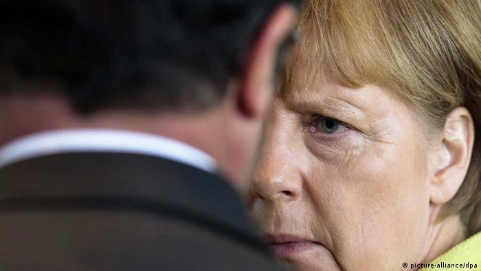 Анґела Меркель (праворуч) та Франсуа Олланд