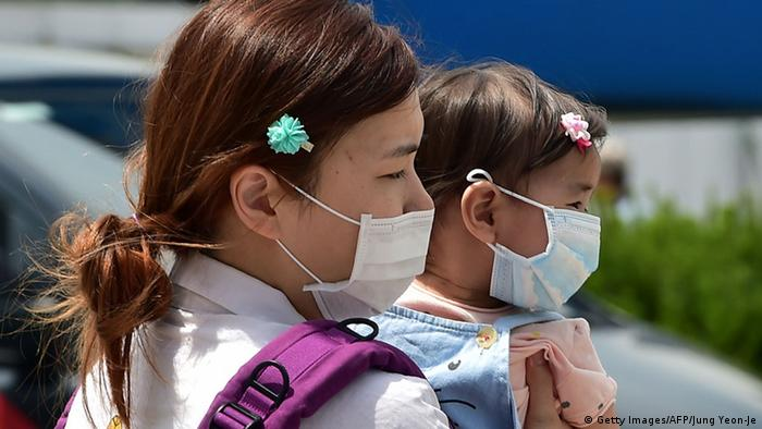 South Koreans were masks over their mouths and noses to avoid the virus