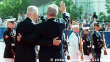 US President Bill Clinton (R) and Russian President Boris Yeltsin embrace as they wave to spectators after Yeltsin's arrival for meetings at the Denver Public Library in Denver, CO 21 June. Today marks the start of the Denver Summit of the Eight. dpa - COLORplus -
