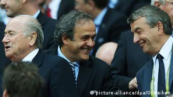 Michel Platini and Wolfgang Niersbach shake hands