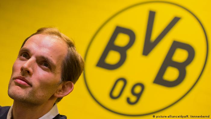 Thomas Tuchel listens to questions at the Borussia Dortmund press conference on Wednesday