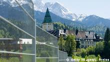 GARMISCH-PARTENKIRCHEN, GERMANY - MAY 28: The Schloss Elmau luxury hotel and spa, which is the venue for the upcoming G7 summit, is seen through a fence on May 28, 2015 near Garmisch-Partenkirchen, Germany. Police are preparing far-reaching measures that include security checks along Germany's southern border crossings that went into effect two days ago in order to safeguard the June 7-8 summit. (Photo by Lennart Preiss/Getty Images)
