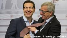 Eastern Partnership Summit. President of the European Commission Jean Claude Juncker (right) jokes with Greek Prime Minister Alexis Tsipras (centre) as he is welcomed on stage beside the President of the European Council, Donald Tusk, as leaders meet today at the Eastern Partnership Summit in Riga, Latvia. Picture date: Friday May 22, 2015. David Cameron has vowed to deliver real reform of the European Union as he met with fellow EU leaders for the first time since his general election victory. See PA story POLITICS EU. Photo credit should read: Stefan Rousseau/PA Wire URN:23086895 pixel